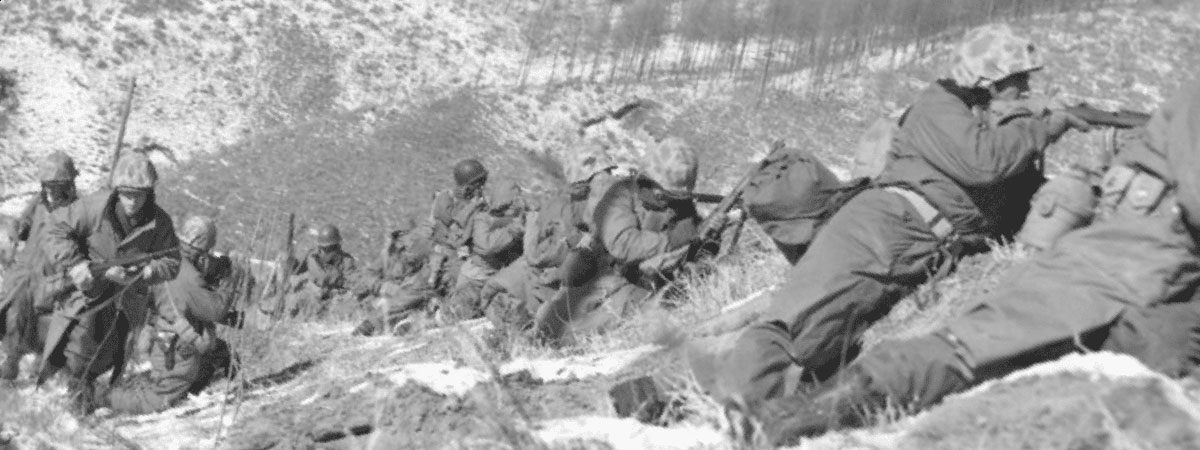 Marines taking cover at the battle of Chosin Reservoir. (Black & White photo)