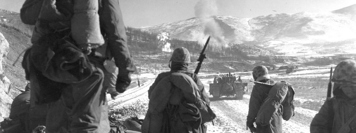Troops approaching smoke from an explosion in the distance. (Black & White photo)